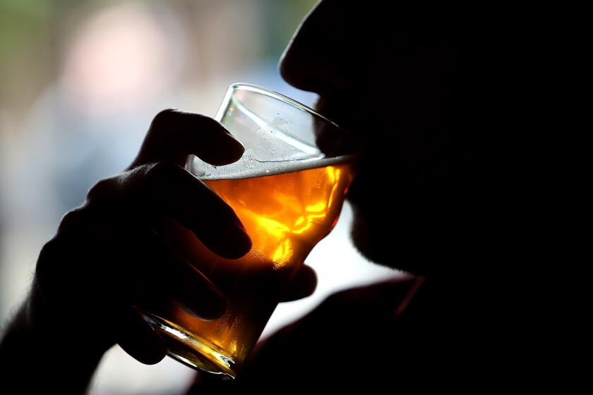 A customer takes a sip of beer at an unspecified brewery.