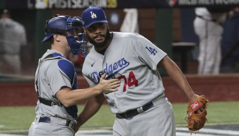 Dodgers relief pitcher Kenley Jansen and catcher Will Smith celebrate after the final out of a 7-3 win.