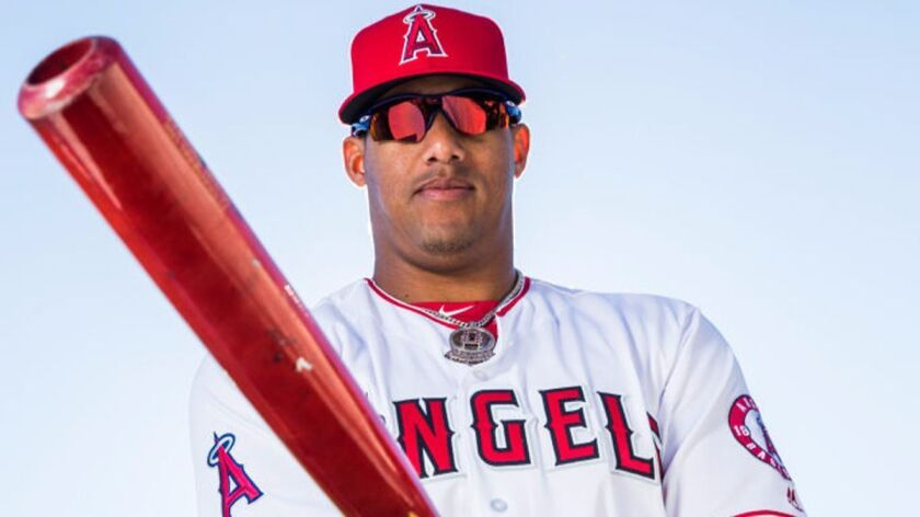 Angels' Yunel Escobar poses for a portrait with his bat during Angels Photo Day at Tempe Diablo Stad