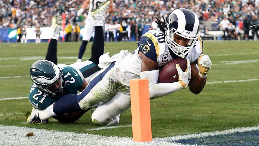 LOS ANGELES, CALIFORNIA DECEMBER 10, 2017-Rams running back Todd Gurley is tackeled short of the goa
