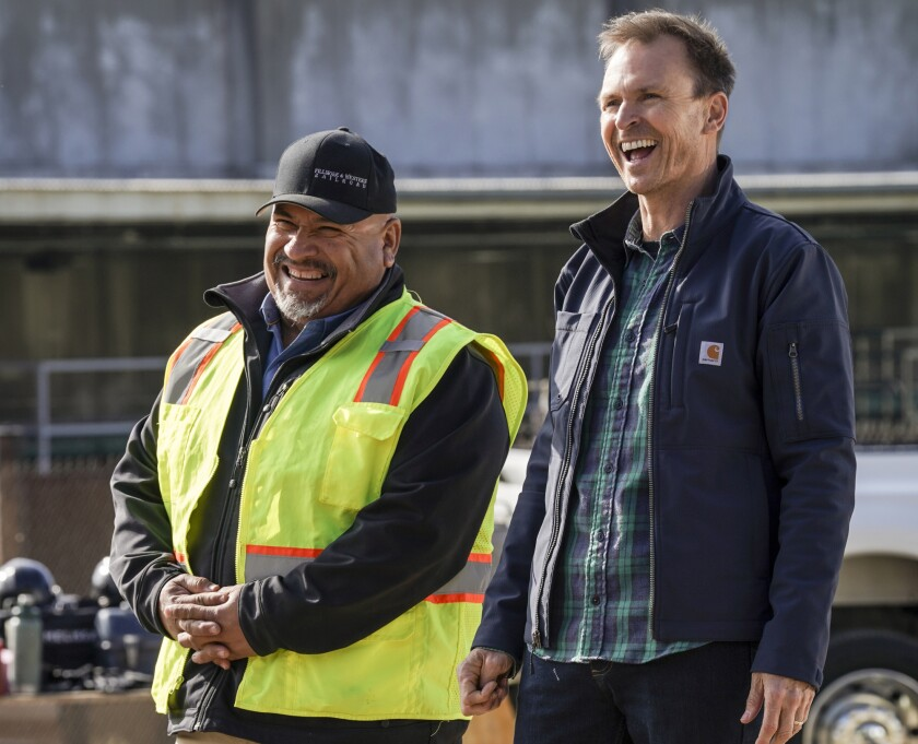 """Host Phil Keoghan, right, in """"Tough as Nails"""" on CBS."""