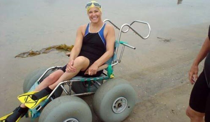 Amelia Opean of La Jolla swims regularly at La Jolla Shores. The chair she's in was recently repaired. Photo: Courtesy