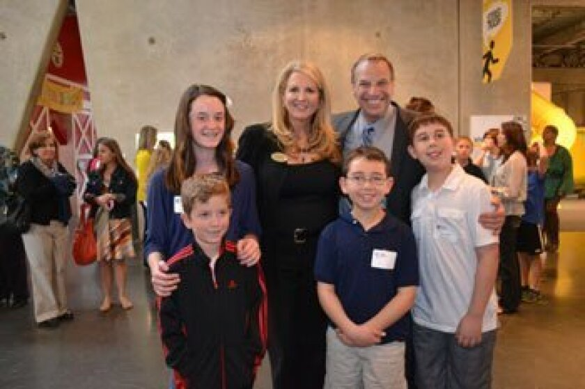 Back row: Morgan Schreiber, Executive Director and Co-Founder of Kids for Peace Jill McManigal and San Diego Mayor Bob Filner. Front row: Matthew Schreiber, Jack Phillips and Joseph Phillips — Photo and report Stacey Phillips