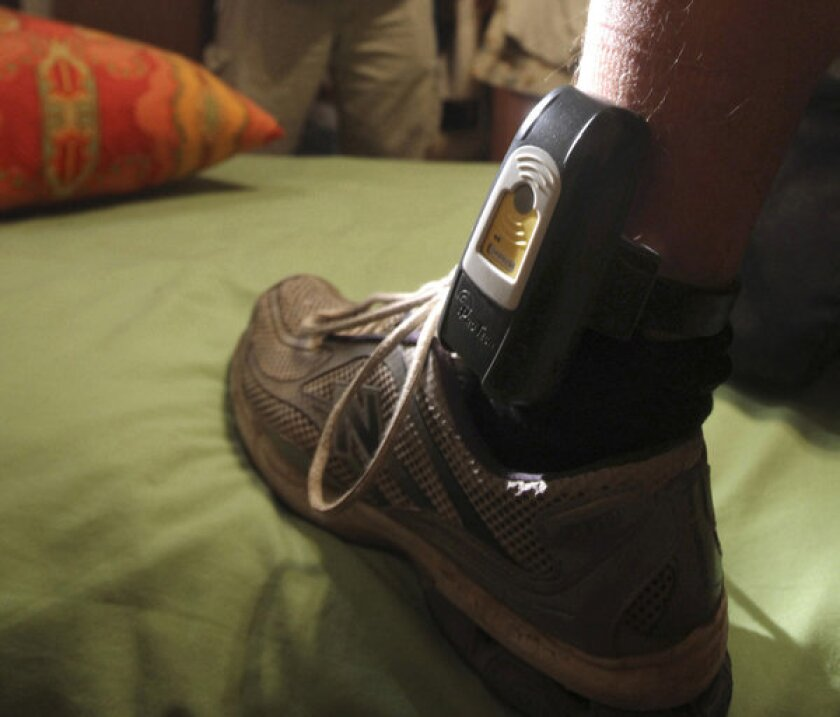 Probationers and defendants are often forced to wear electronic ankle bracelets.
