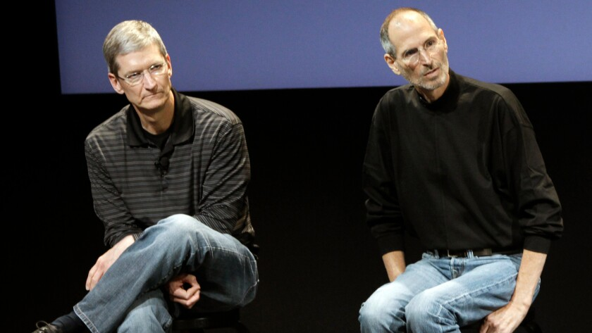 Apple Chief Executive Tim Cook, left, shown with his predecessor, Steve Jobs, at a 2010 corporate event, is facing a ginormous tax bill.