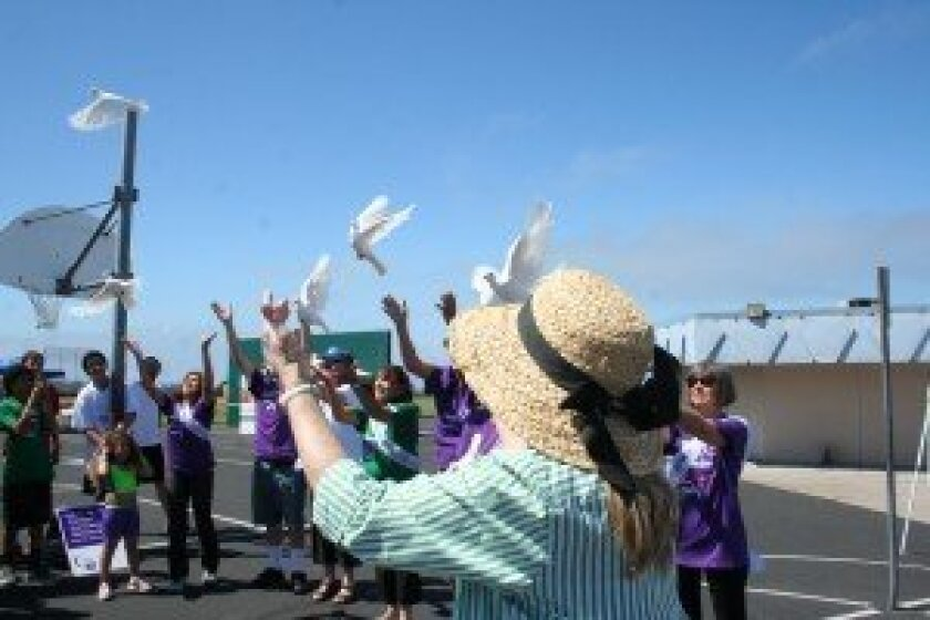 Cancer survivors releasing doves as a symbol of hope. Photo/Kristina Houck