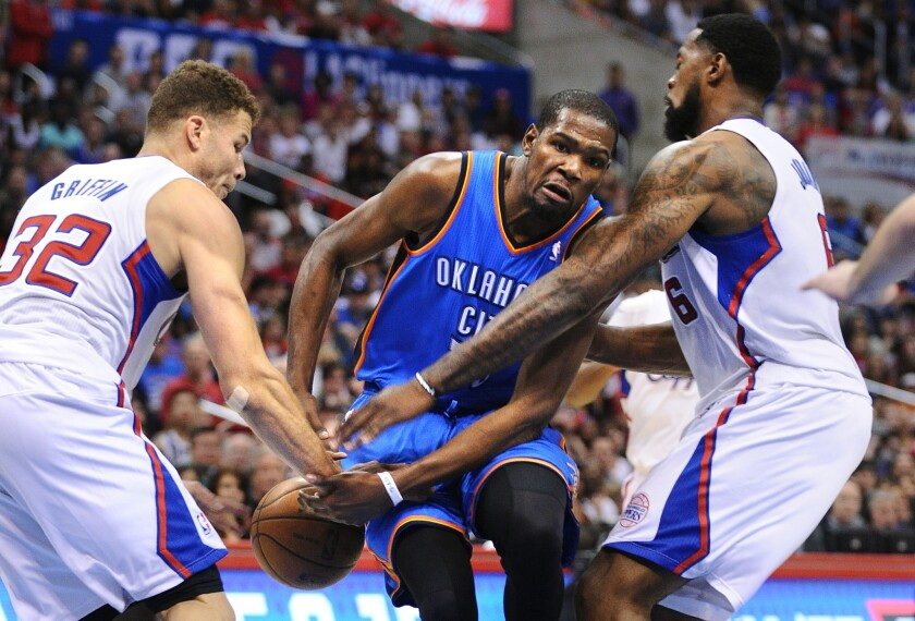 Clippers power forward Blake Griffin strips the ball from Thunder forward Kevin Durant as he tries to drive to the basket against Griffin and center DeAndre Jordan.