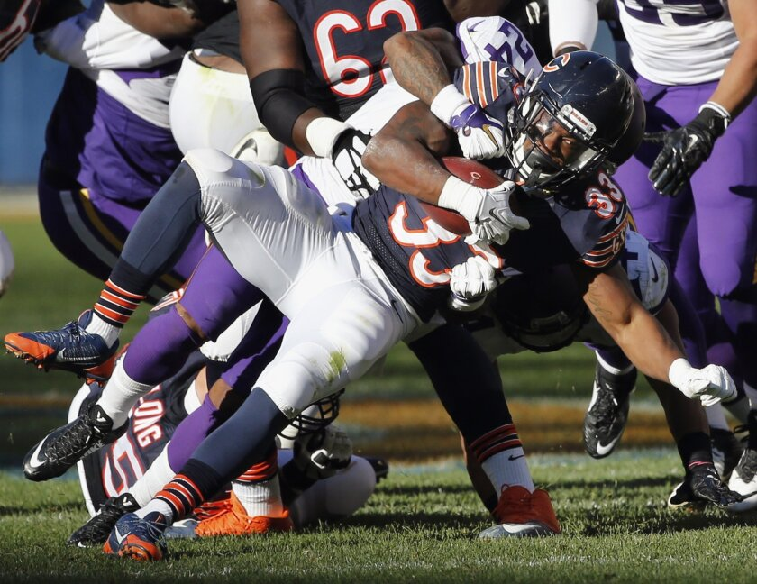 FILE - In this Nov. 1, 2015, file photo, Chicago Bears rookie running back Jeremy Langford (33) is tackled by Minnesota Vikings cornerback Captain Munnerlyn (24) during an NFL football game in Chicago. With star running back Matt Forte expected to be out of the lineup, the Bears figure to give rook