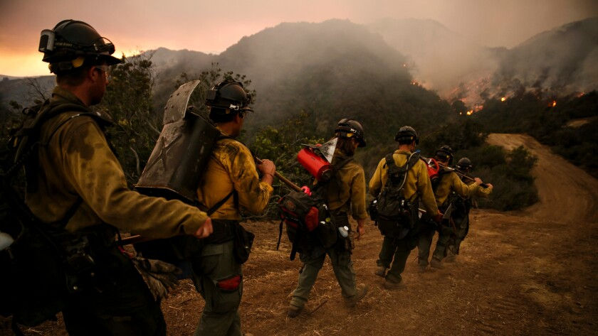 Firefighters marched into El Capitan Canyon in Santa Barbara County on Friday, trying to corral the Sherpa fire before winds pick up.