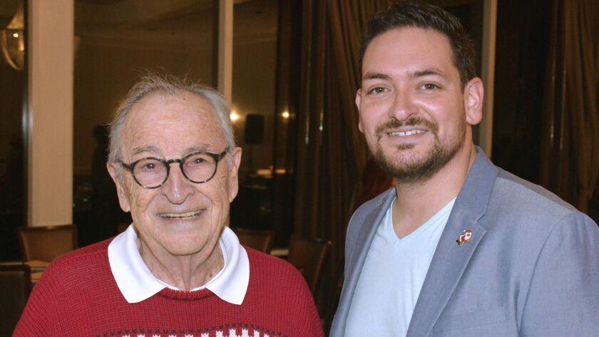 Burbank Rotary President Albert Hernandez, right, honored former school board member Peter McGrath w