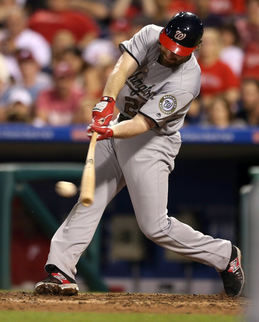 Washington Nationals' Daniel Murphy (20) hits an RBI-single on Philadelphia Phillies pitcher Hector Neris allowing Ben Revere and Jayson Werth to score in the eighth inning of a baseball game Monday, May 30, 2016, in Philadelphia. The Nationals won 4-3. (AP Photo/Laurence Kesterson)