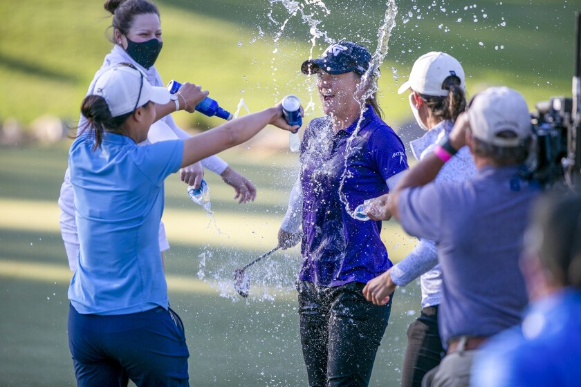Austin Ernsts celebrates her win and gets a beer bath from fellow golfer Danielle Kang at the final round of the LPGA golf tournament in Ocala, Fla., Sunday, March 7, 2021. (Alan Youngblood/Ocala Star-Banner via AP)