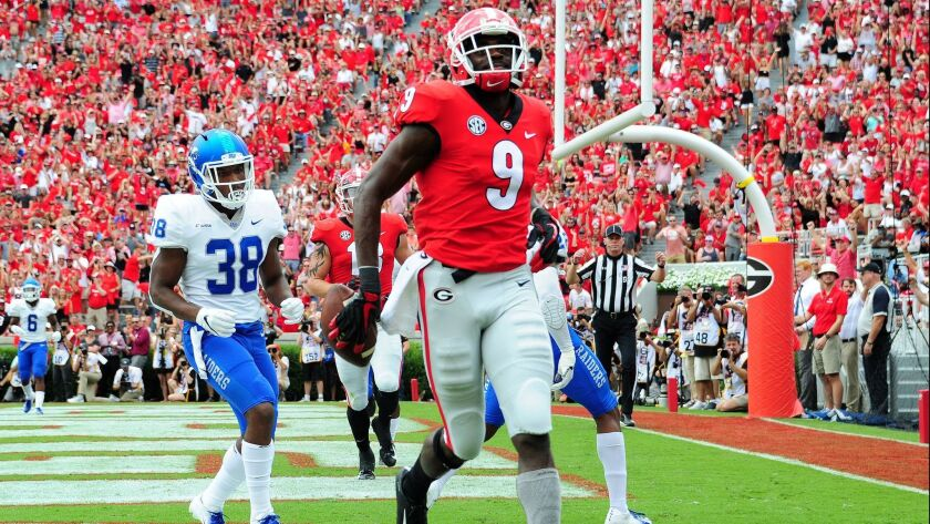 Georgia's Jeremiah Holloman makes a catch for a touchdown against Middle Tennessee on Saturday at Sanford Stadium in Athens, Ga.