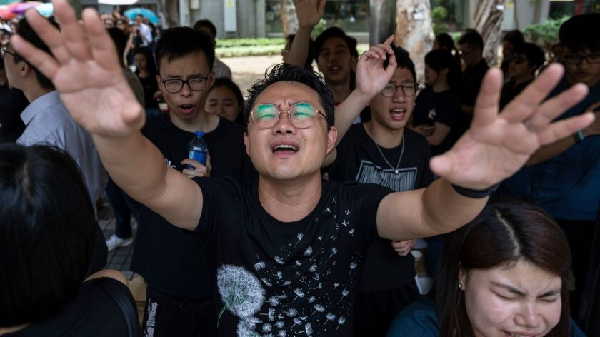 Christians sings hymns to voice their opposition to the extradition law, Hong Kong, China - 14 Jun 2019