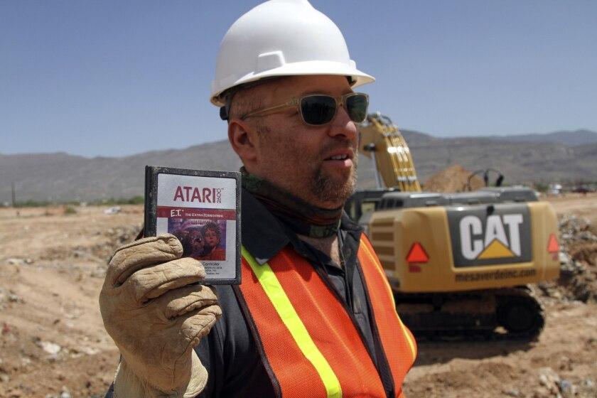 Film Director Zak Penn shows a box of a decades-old Atari 'E.T. the Extra-Terrestrial' game cartridges found in a landfill in Alamogordo, N.M.