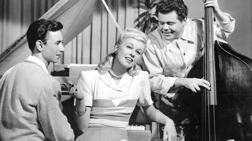 "Doris Day (Center) as 'Georgia Garrett' in ""ROMANCE ON THE HIGH SEAS"" (1948), directed by Michael Cu"