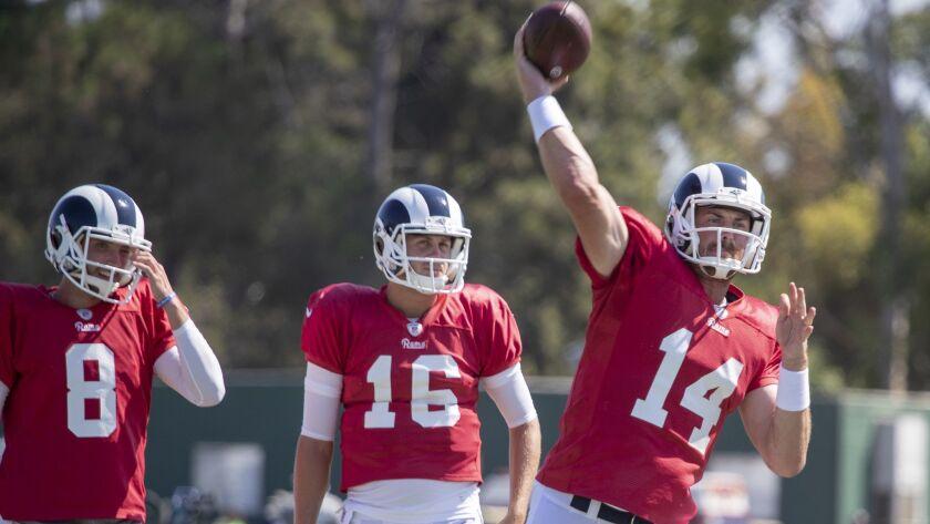 IRVINE, CALIF. -- MONDAY, AUGUST 13, 2018: Rams quarterbacks Brandon Allen, left, and Jared Goff, ce
