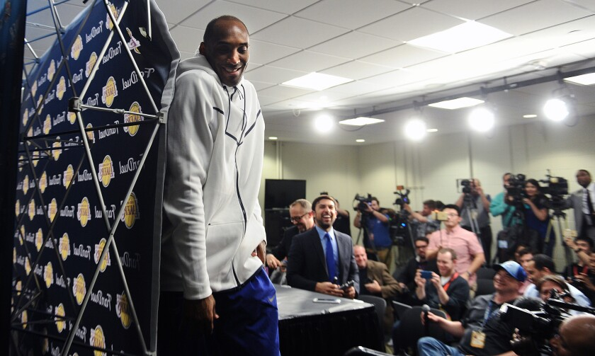 Kobe Bryant leaves a news conference with a laugh after a game against the Thunder in Oklahoma City on April 11.