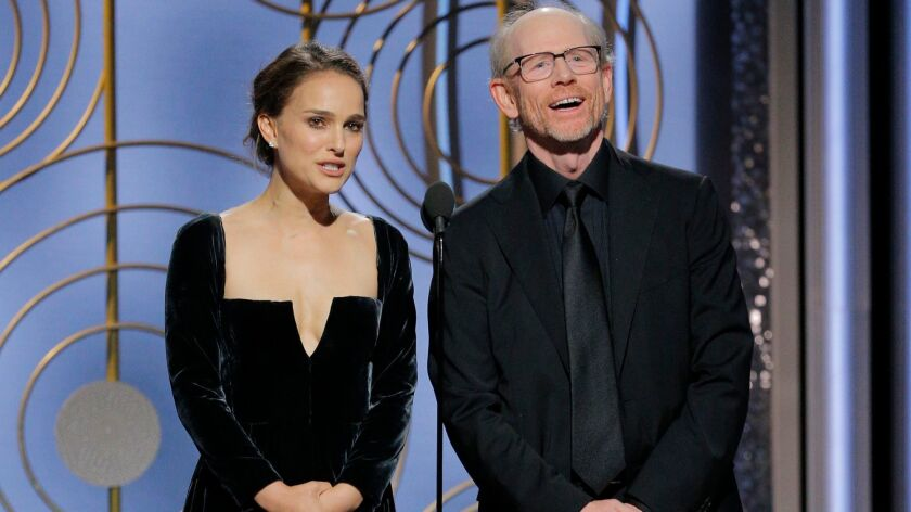 This image released by NBC shows presenters Natalie Portman, left, and Ron Howard at the 75th Annual