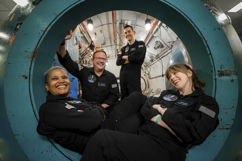 In this July 2, 2021 photo provided by John Kraus, from left, Sian Proctor, Chris Sembroski, Jared Isaacman and Hayley Arceneaux pose for a photo at Duke Health in Durham, N.C, during hypoxia training to understand how each crew member reacts in a low-oxygen environment. (John Kraus/Inspiration4 via AP)
