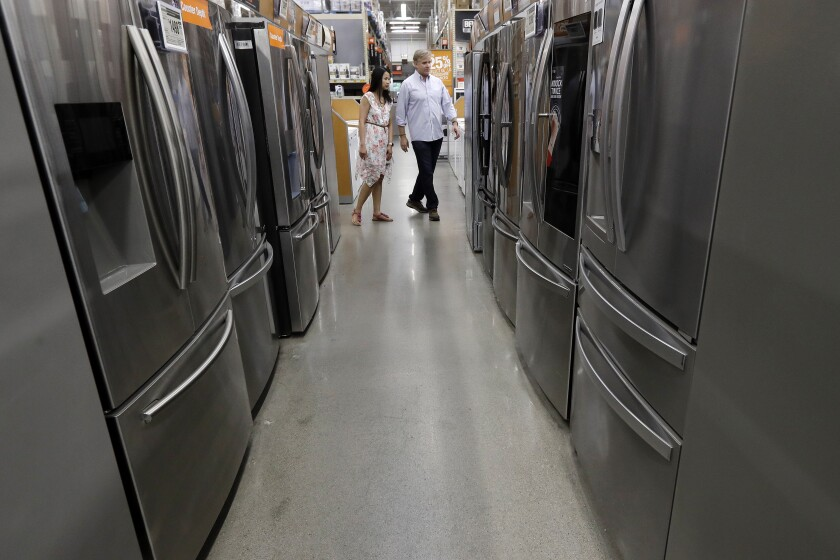 In this Monday, Sept. 23, 2019 photo shoppers examine refrigerators at a Home Depot store location, in Boston. On Friday, Sept. 27, the Commerce Department issues its August report on consumer spending, which accounts for roughly 70 percent of U.S. economic activity. (AP Photo/Steven Senne)