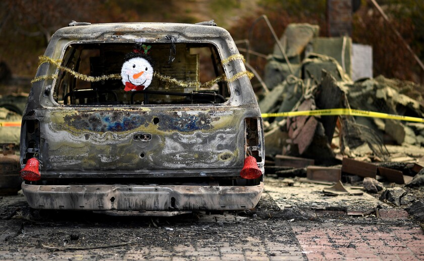 VENTURA, CALIFORNIA DECEMBER 24, 2017-Christmas ornaments are hung from a burned car along High Poin