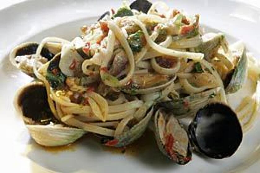 A spiced-up linguine with clam sauce has a dash of Molina's sensibility.