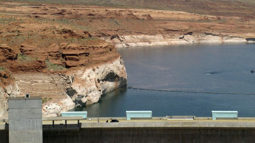 Lake Powell is viewed behind Glen Canyon Dam near Page, Ariz.