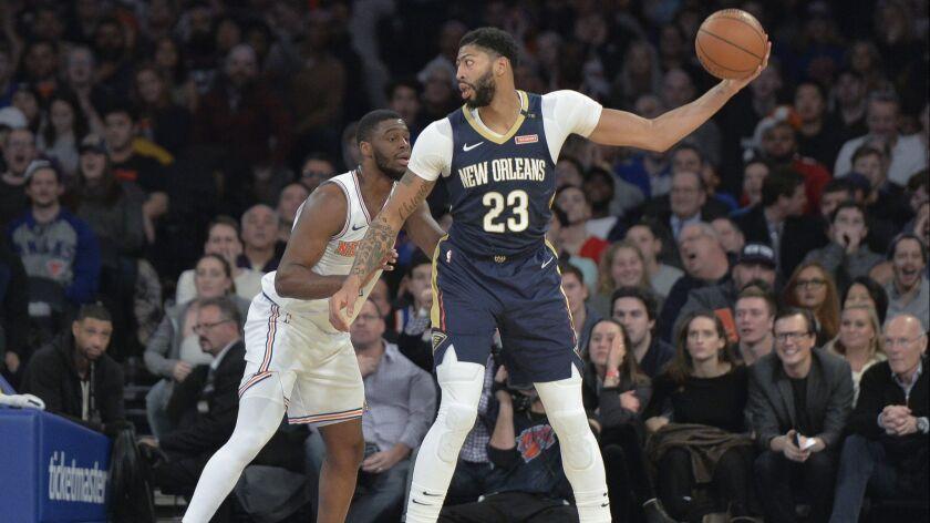 New Orleans Pelicans forward Anthony Davis (23) works against New York Knicks guard Emmanuel Mudiay