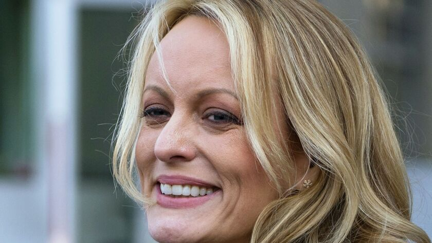 FILE - In this April 16, 2018 file photo, adult film actress Stormy Daniels speaks to members of the