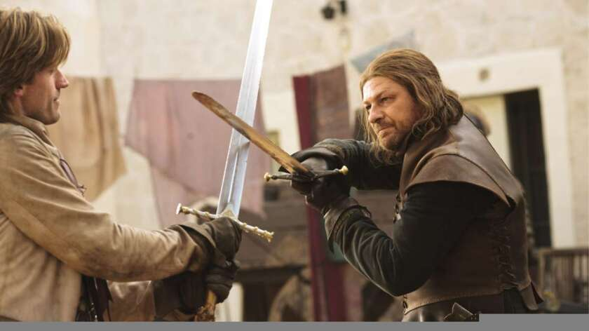 """In the first season of HBO's """"Game of Thrones, Eddard Stark, right, holds his Valyrian steel sword, Ice, in a contest of wills with Jamie Lannister."""