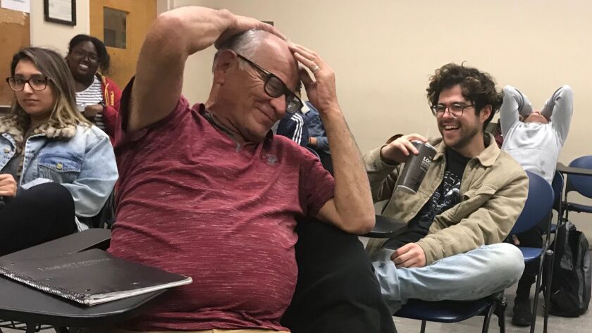 Jerry Valencia laughs during class at Cal State Los Angeles recently. Valencia is a 63-year-old junior at the school.