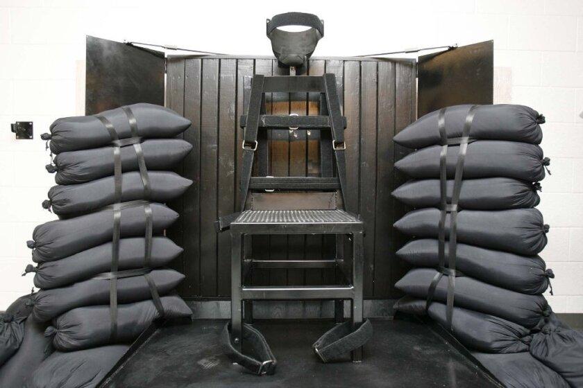 Utah governor signs firing-squad bill