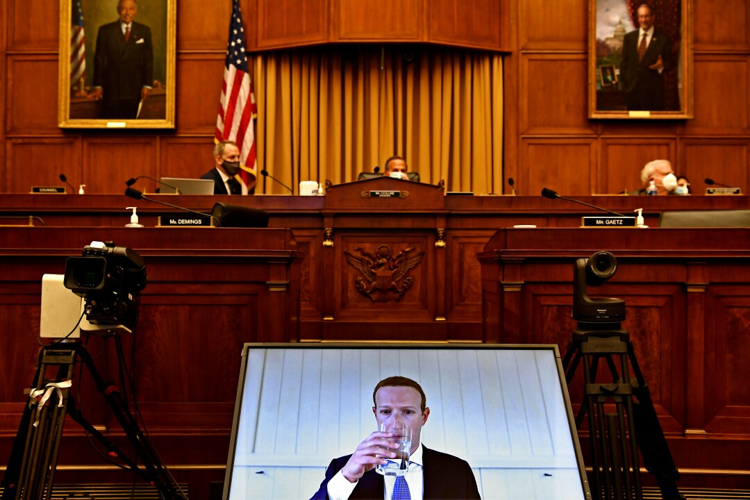 Facebook CEO Mark Zuckerberg is seen onscreen during remote testimony before House lawmakers on Capitol Hill.
