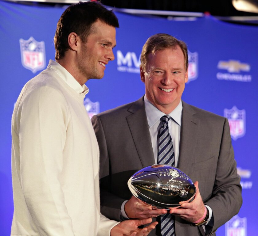 """FILe - In this Feb. 2, 2015, file photo, New England Patriots quarterback Tom Brady, left, poses with NFL Commissioner Rodger Goodell during a news conference where Goodell presented Brady with the MVP award from the NFL Super Bowl XLIX football game. Brady wants to call Commissioner Goodell as a witness in the appeal of the four-game suspension he was handed for """"Deflategate."""" (John Samora/The Arizona Republic via AP, File) MARICOPA COUNTY OUT; MAGS OUT; NO SALES"""