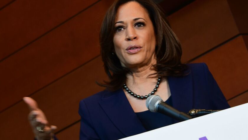 Sen. Kamala Harris speaks to reporters Jan. 21 at Howard University in Washington.