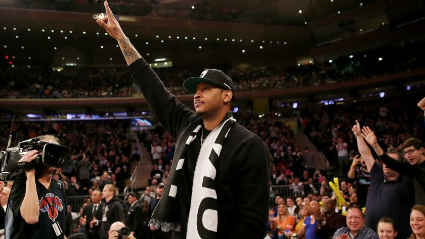Carmelo Anthony waves to the fans at Madison Square Garden during the first quarter of a game between the Knicks and Heat on Jan. 27.