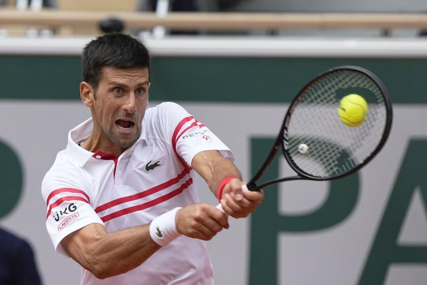Novak Djokovic plays a return to Lorenzo Musetti.