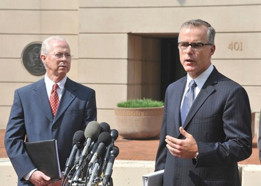 <p>Andrew McCabe, right, makes a rare public appearance in 2015. With him is Dana J. Boente, the U.S