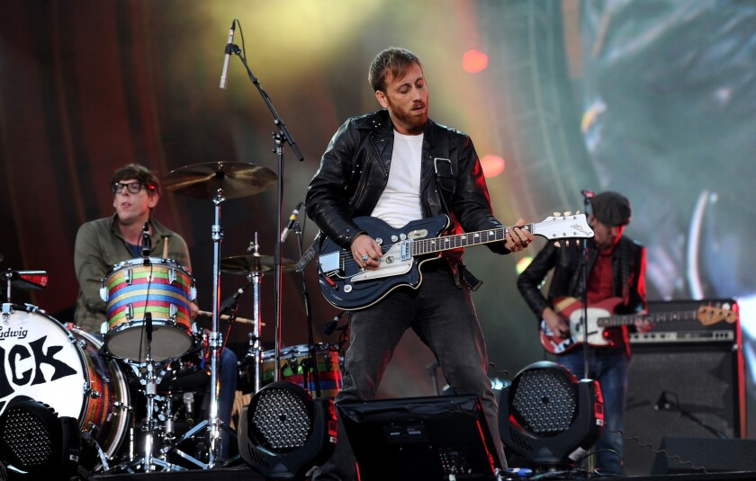 The Black Keys, shown performing in New York's Central Park in 2012, will headline the 2013 KROQ Weenie Roast on May 18 in Irvine.