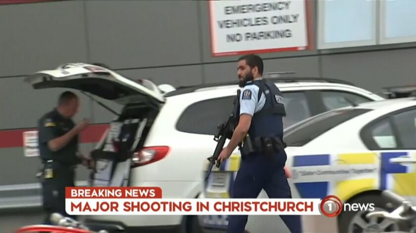 An image grab from TV New Zealand taken Friday shows an armed police officer at a hospital following the mosque shootings in Christchurch.