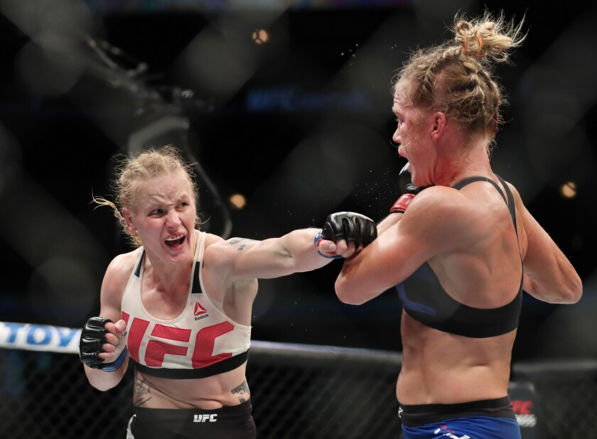 July 23, 2016; Chicago, IL, USA; Holly Holm (red gloves) competes against Valentina Shevchenko (blue gloves) in their women's bantamweight bout during UFC Fight Night at United Center. Mandatory Credit: Kamil Krzaczynski-USA TODAY Sports ** Usable by SD ONLY **