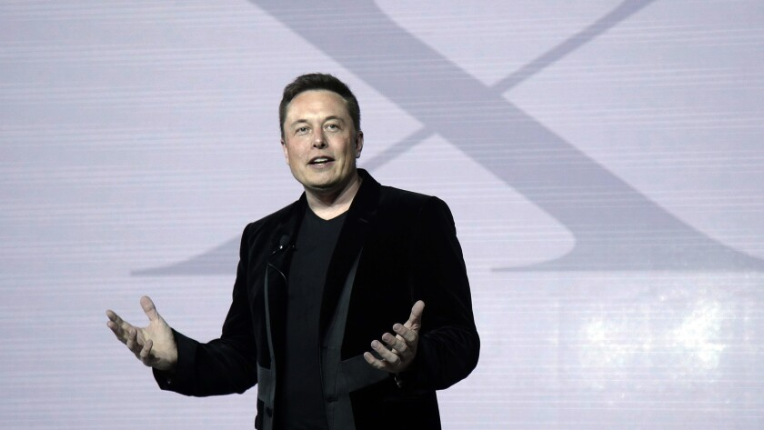 "Tesla Motors CEO Elon Musk, seen here at the September 2015 introduction of the Model X ""falcon-wing"" SUV, addressed shareholders in Mountain View, Calif."