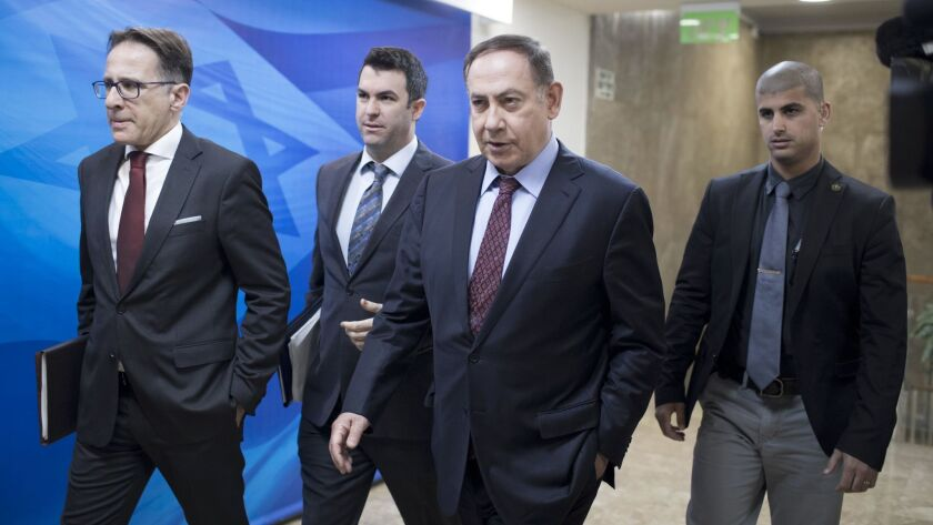 Israeli Prime Minister Benjamin Netanyahu, second right, arrives to the weekly cabinet meeting at hi