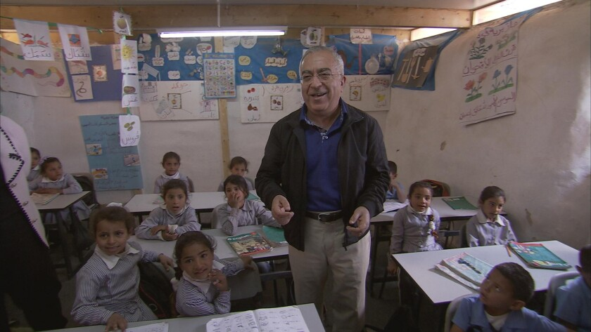 """In an image from """"State 194,"""" former Palestinian Authority Prime Minister Salam Fayyad pays a visit to a new West Bank school, one of the institutional building blocks he had hoped would underpin the territory's bid for statehood. Fayyad resigned in April but remains committed to the pursuit of a two-state solution."""