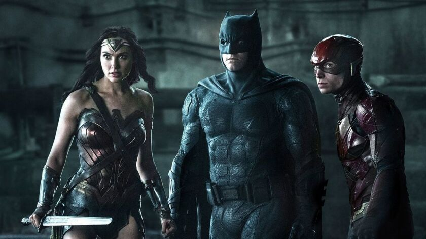 "Gal Gadot, left, Ben Affleck and Ezra Miller costar in the 2017 superhero drama ""Justice League"" on HBO."