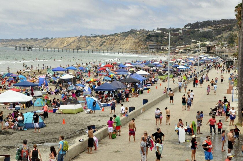 The crowded beach and boardwalk at La Jolla Shores on a cloudy July 4, 2016