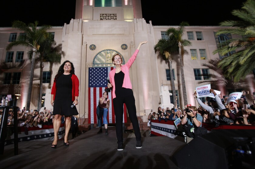 Assemblywoman Lorena Gonzalez (D-San Diego), left, introduces Elizabeth Warren at a rally in San Diego on Thursday.