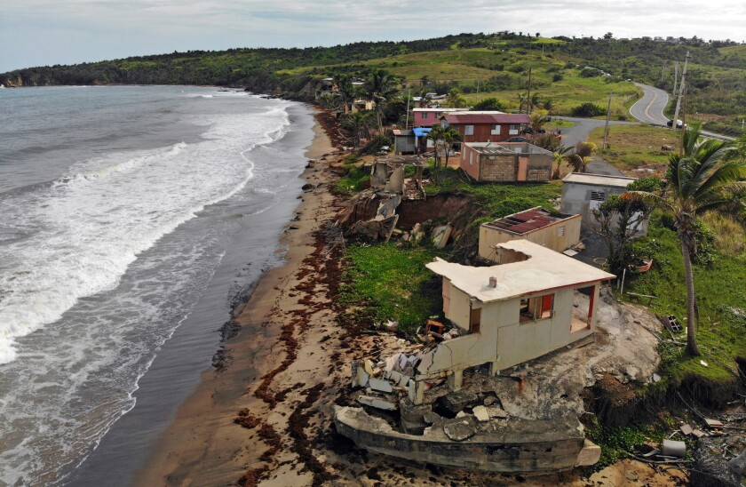 A year after Hurricane Maria, homes remain in ruins along the beach in Yabucoa, Puerto Rico.