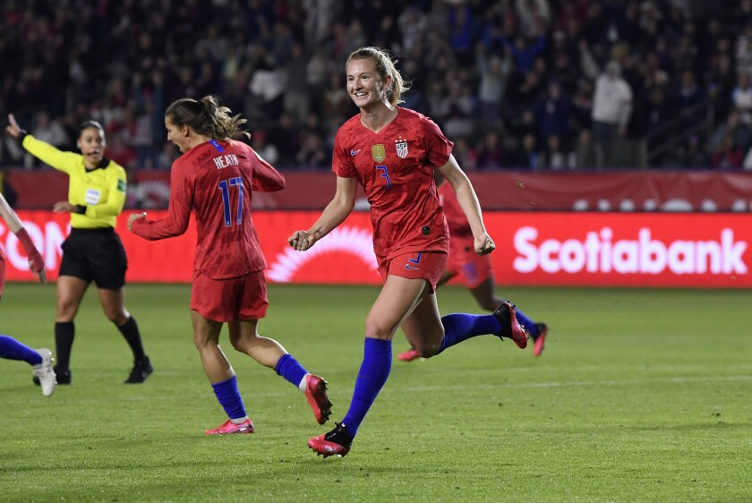 Sam Mewis, right, celebrates one of her two goals in the United States' 4-0 win over Mexico on Feb. 7, 2020, in Carson.